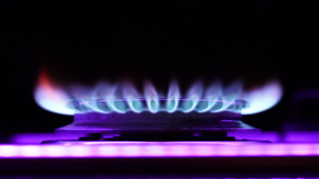 a low angle view of the flames from a gas hob - gas stock videos & royalty-free footage