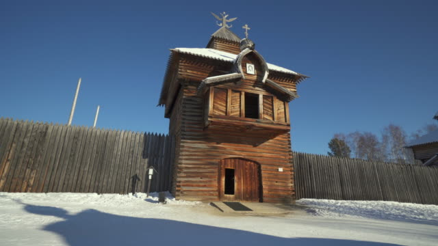 low angle view of tower at taltsy museum against clear blue - lake baikal, russia - church stock videos & royalty-free footage