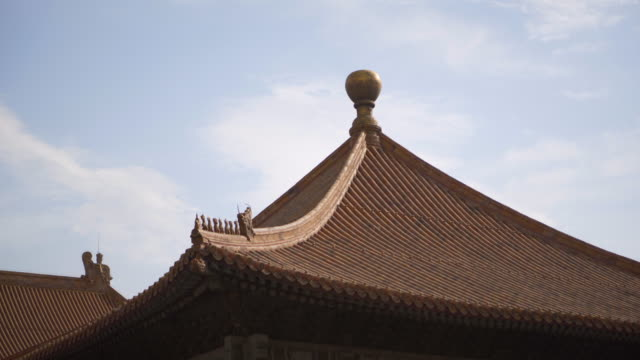 low angle view of traditional roof structure at forbidden city against sky - beijing, china - forbidden city stock videos & royalty-free footage