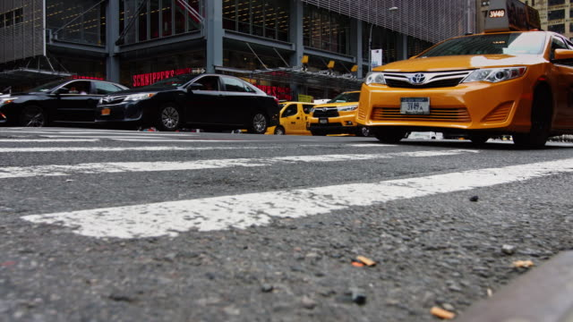 low angle view of traffic on eighth avenue, new york city - yellow taxi video stock e b–roll