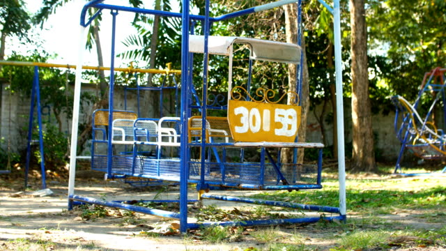 low angle view of train swing in playground park - gold rush stock videos and b-roll footage