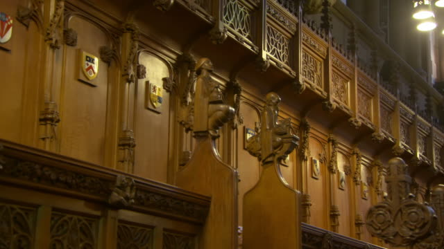 low angle view of wooden statues against wall at public university - glasgow, scotland - statue stock-videos und b-roll-filmmaterial