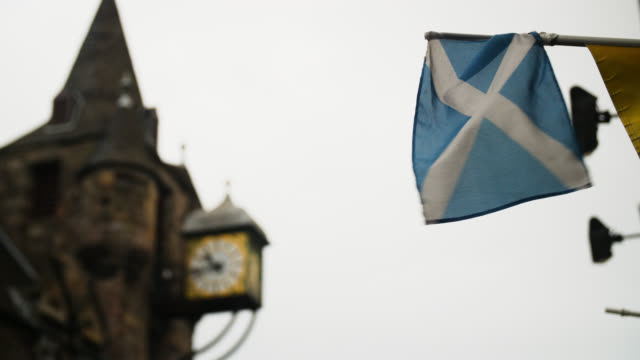 low angle view scottish flag blowing in wind - furzen stock-videos und b-roll-filmmaterial