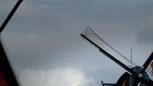 low angle view windmills turning, netherlands - standbildaufnahme stock-videos und b-roll-filmmaterial