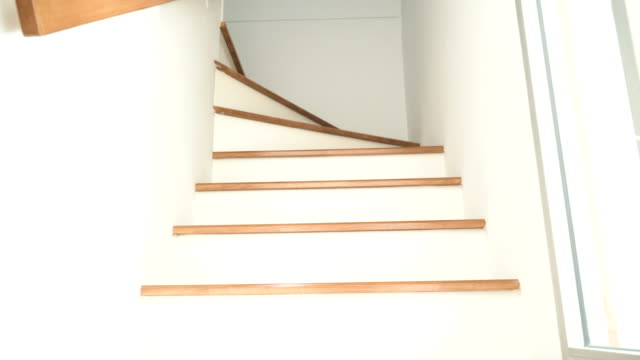 low angle view: wooden ladder in new home - staircase stock videos & royalty-free footage