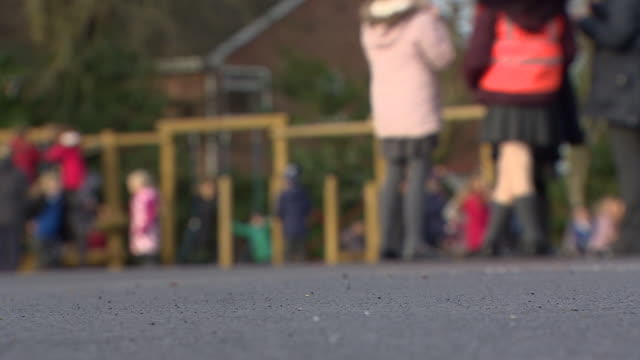 low angle views of children in a playground - image focus technique stock videos & royalty-free footage