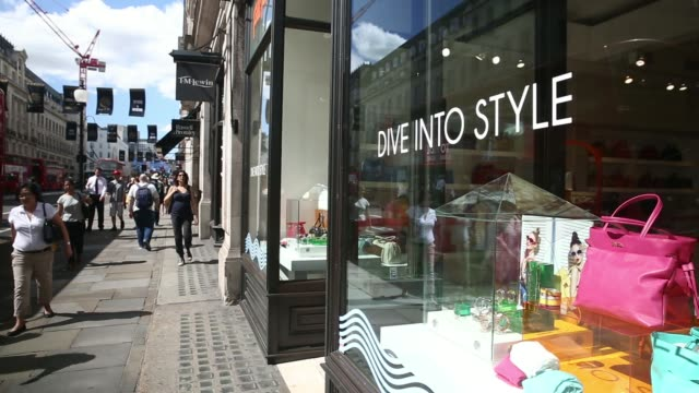 low angle views signage hangs outside a folli follie store on regent street in central london, uk, on tuesday, june 10 various general views window... - purse stock videos & royalty-free footage