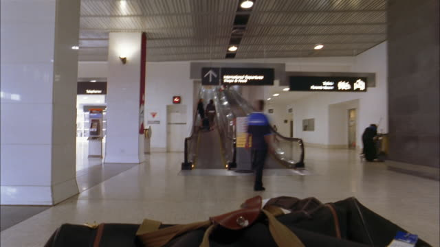 low angle walking point of view time lapse through airport ramp and stores - koffer stock-videos und b-roll-filmmaterial
