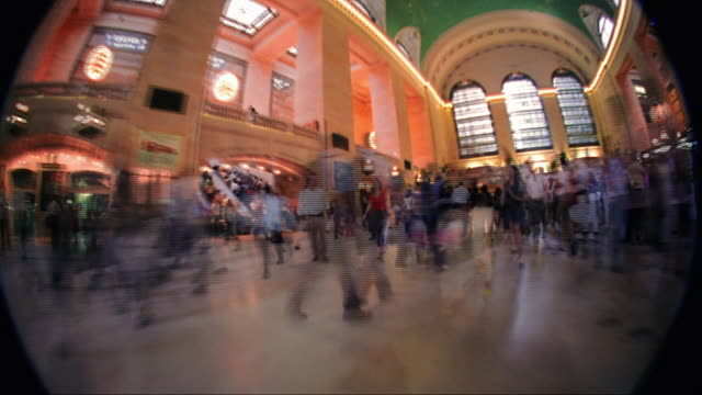 low angle walking point of view time lapse through crowds of people in grand central station / nyc - following stock videos & royalty-free footage