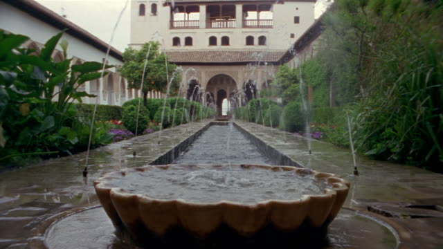low angle wide fountains at generalife gardens/ alhambra, spain - squirting stock videos and b-roll footage