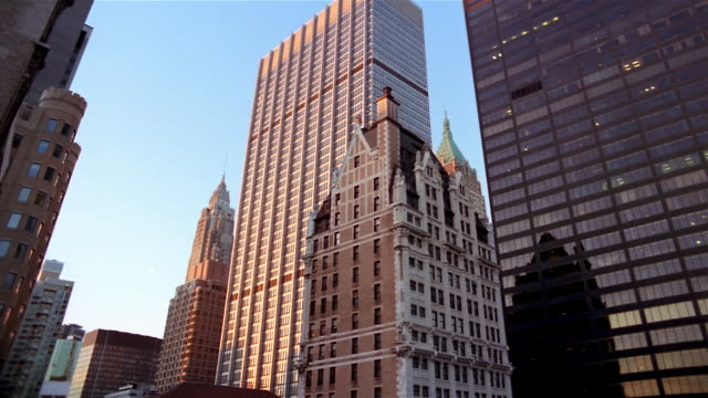 low angle wide shot american international building, chase manhattan tower, liberty tower and hsbc building/ nyc - gothic stock videos & royalty-free footage