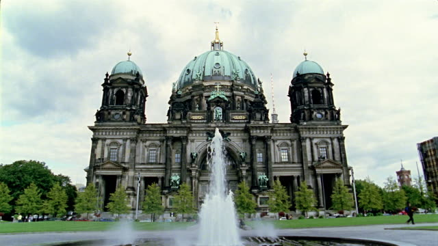 Low angle wide shot Berlin Cathedral (Berliner Dom) with fountain in foreground