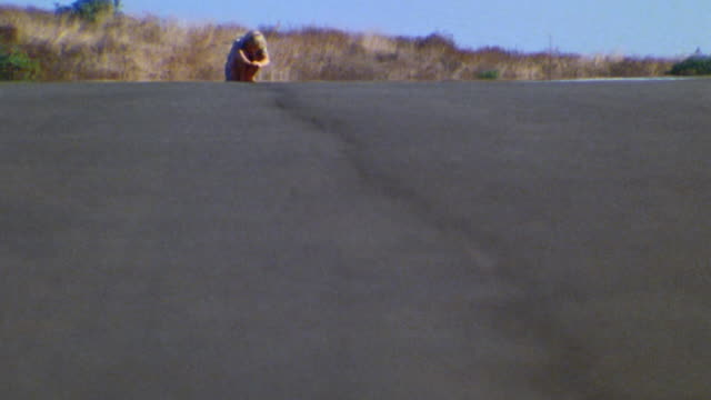 low angle wide shot boy crouching barefoot on skateboard towards and past cam - 1976 stock videos & royalty-free footage