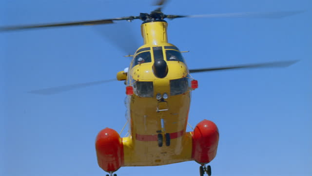 Low angle wide shot CH-113 Labrador Canadian SAR helicopter taking off on clear day / British Columbia, Canada