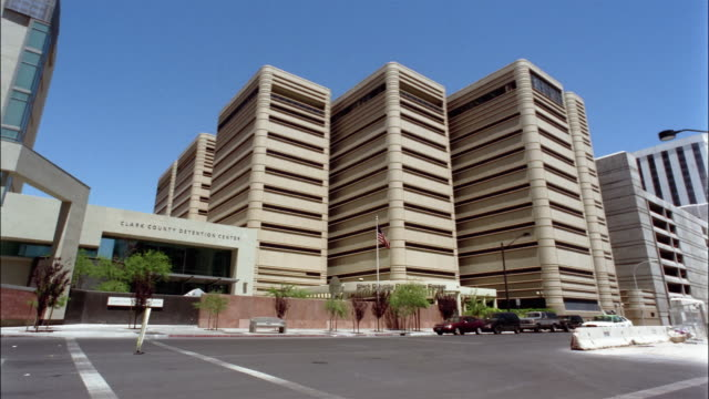 low angle wide shot clark county detention center/ las vegas, nevada - clark county nevada stock videos & royalty-free footage