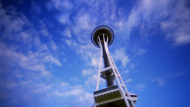 low angle wide shot dolly shot time lapse clouds rolling over space needle / seattle - space needle stock videos & royalty-free footage