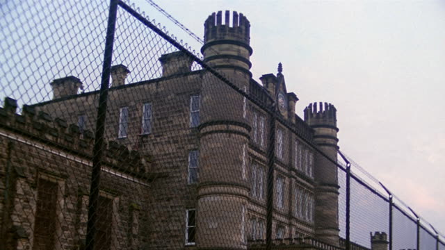 low angle wide shot exterior of west virginia state penitentiary - blocco stradale video stock e b–roll
