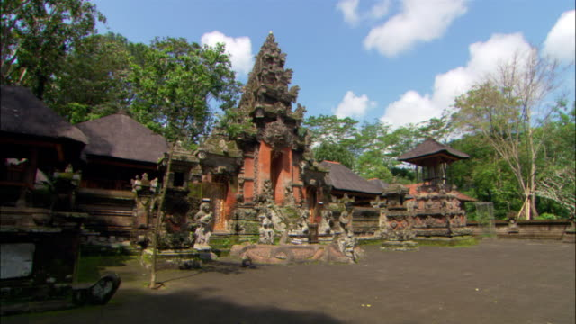 Low angle wide shot exterior view of the Pura Dalem Agung Temple near Ubud Monkey Forest Sanctuary / Bali, Indonesia