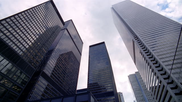 low angle wide shot looking up at towers of toronto-dominion centre in financial district / toronto - kelly mason videos stock videos & royalty-free footage