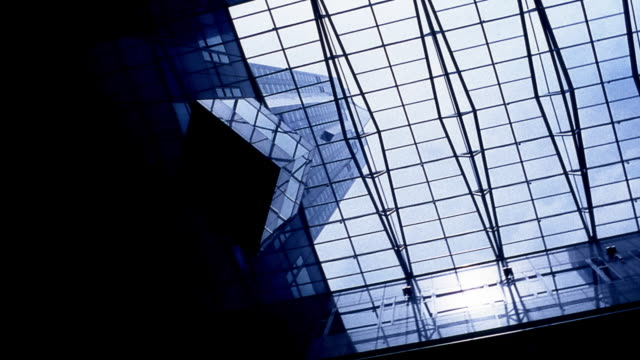 Low angle wide shot pan glass ceiling of building / Singapore