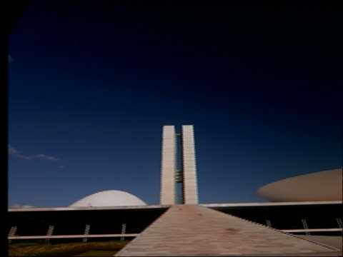 low angle wide shot PAN of Parliament Building in Brasilia, Brazil