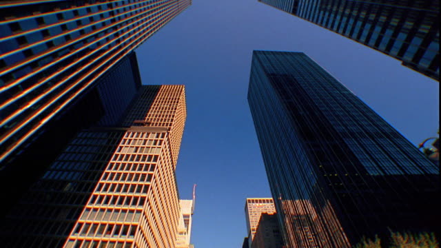 low angle wide shot rear car point of view past skyscraper office buildings / manhattan, new york city - 2001 stock videos and b-roll footage