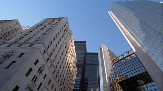 low angle wide shot royal bank plaza south and royal york hotel on front street in financial district / toronto - kelly mason videos stock-videos und b-roll-filmmaterial