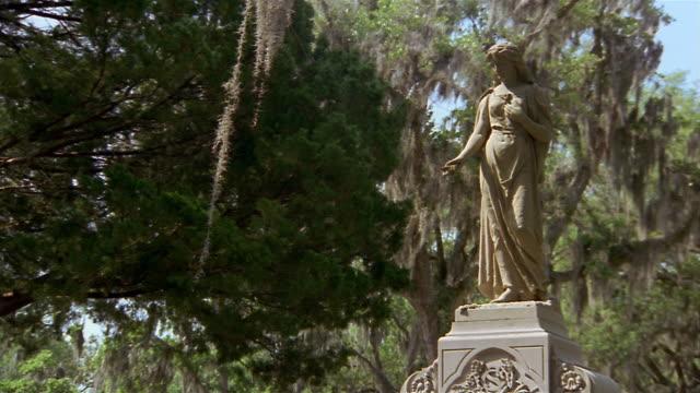 low angle wide shot statue of woman on tomb in bonaventure cemetery / savannah, georgia - savannah georgia stock videos & royalty-free footage