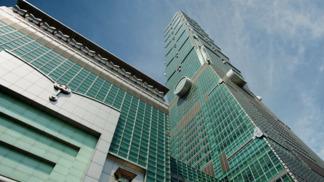low angle wide shot taipei 101 building against sky of moving clouds / taipei, taiwan - taipei 101 stock videos & royalty-free footage