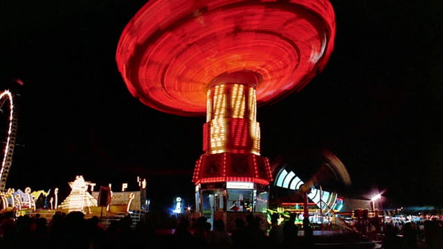 low angle wide shot time lapse spinning swing amusement park ride at night / richmond, virginia - richmond virginia stock videos & royalty-free footage