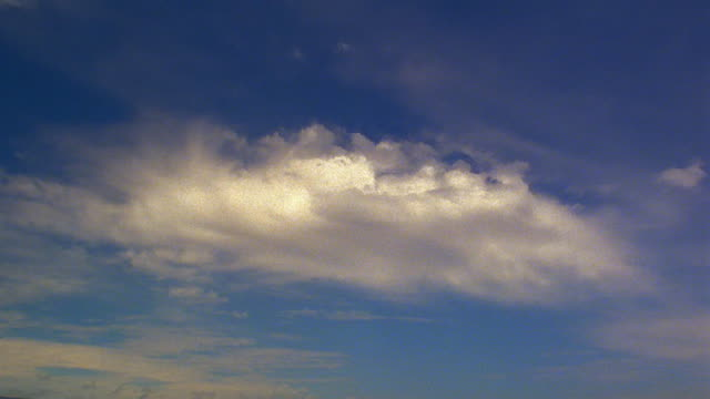 low angle wide shot time lapse white wispy clouds in blue sky / hawaii - wispy stock videos & royalty-free footage
