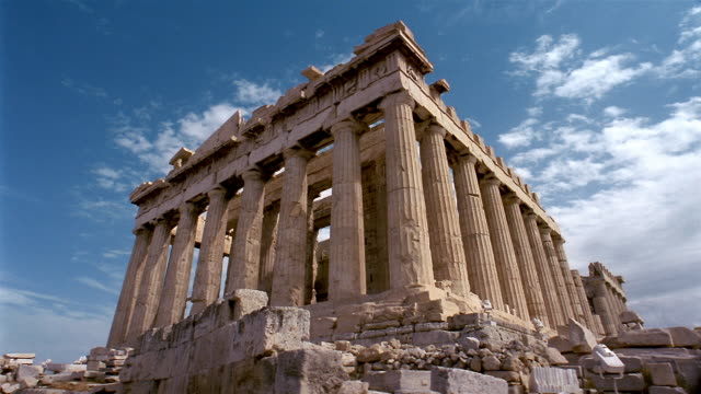 low angle wide shot view of parthenon with clouds overhead / athens, greece - parthenon athens stock videos and b-roll footage