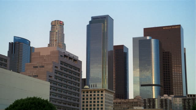 low angle wide shot view of us bank tower, two california plaza and one california plaza / los angeles, california - us bank tower stock videos and b-roll footage