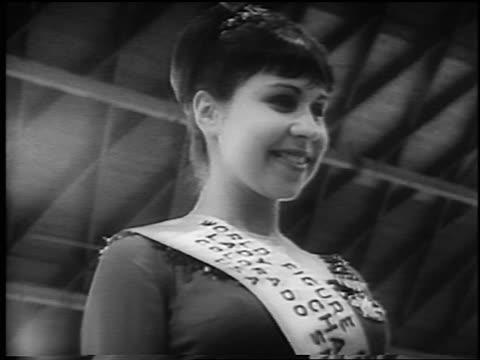 B/W 1965 low angle winner of World Figure Skating Championships Petra Burka smiling / Colorado / newsreel