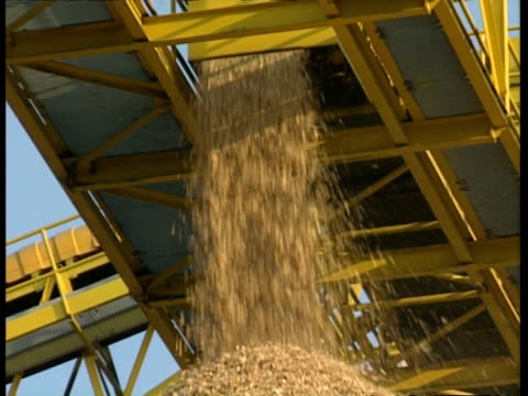 cu low angle, woodchips falling onto large stockpile - timber stock-videos und b-roll-filmmaterial