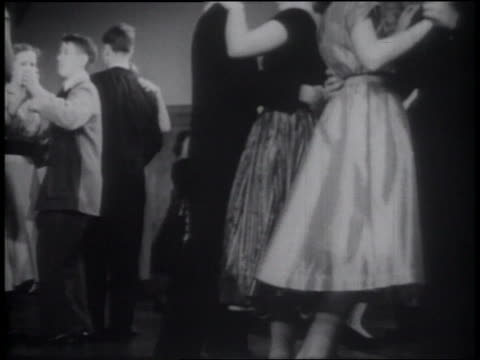 B/W 1953 low angle young teen couples dancing at formal party