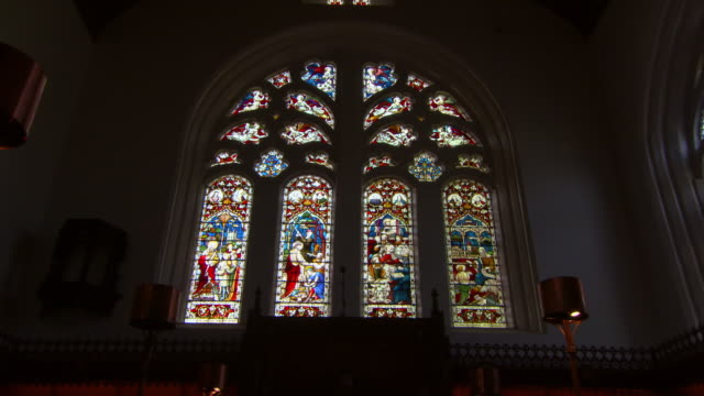 low angle zoom in shot of stained glass window in famous king's college - aberdeen, scotland - church stock videos & royalty-free footage