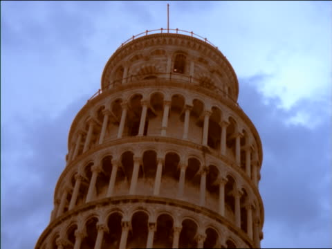 low angle zoom out from close up of top of Leaning Tower of Pisa / Italy