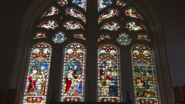 low angle zoom out shot of stained glass window in famous king's college - aberdeen, scotland - arch stock videos & royalty-free footage