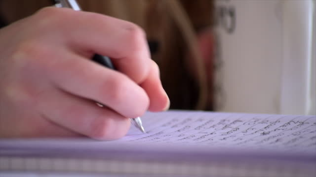 a low close up shot of a student making notes - pen stock videos & royalty-free footage