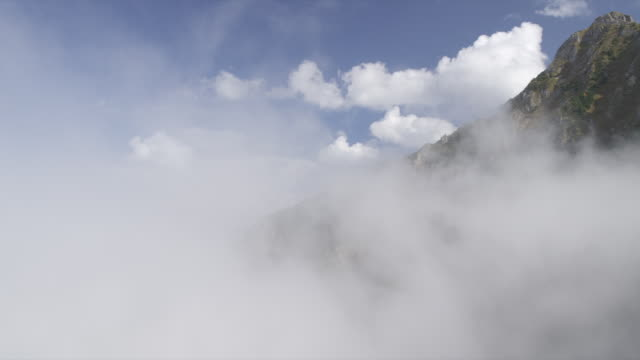 Low clouds cover mountains peaks and range