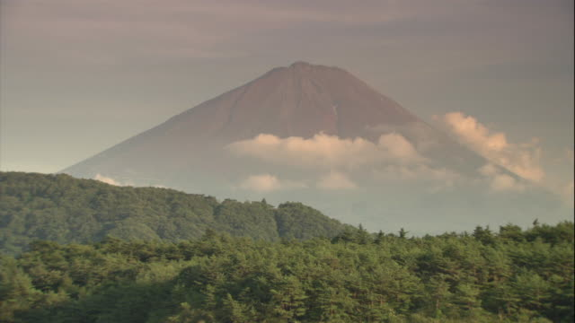low clouds hover above forests near mount fuji, japan. - japan stock videos & royalty-free footage