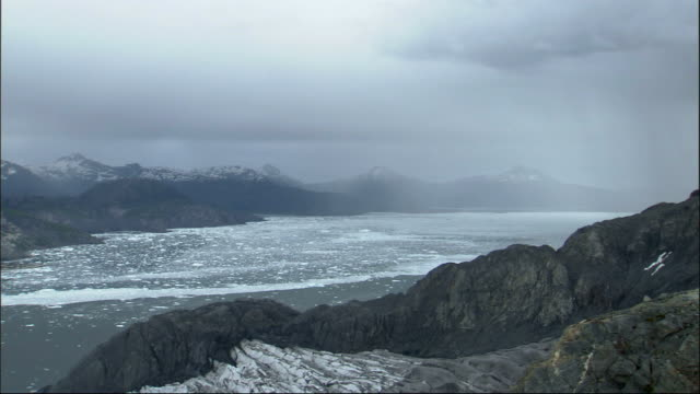 low clouds loom above a bay off columbia glacier alaska. available in hd. - columbia glacier stock videos & royalty-free footage