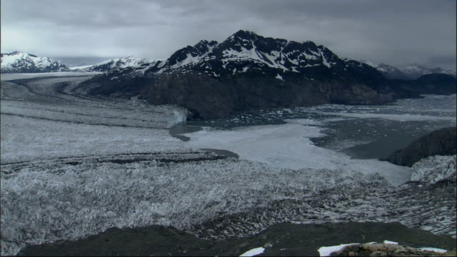 low clouds loom above columbia glacier in alaska. available in hd. - columbia glacier stock videos & royalty-free footage