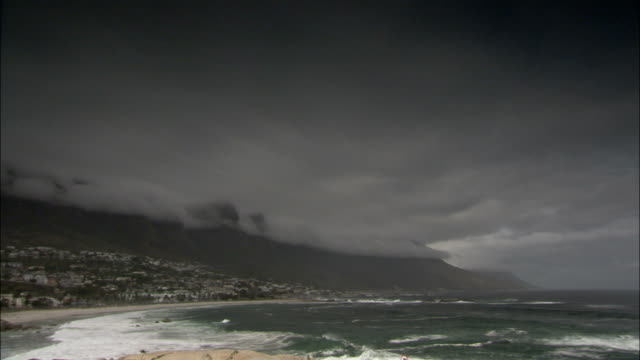Low clouds loom above Table Mountain near Cape Town. Available in HD.