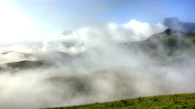 Low clouds moving infront of the Amphitheatre.Drakensburg mountains. South Africa