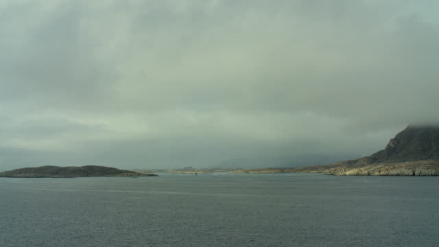 low clouds over coastal landscape - northwest passage stock videos and b-roll footage