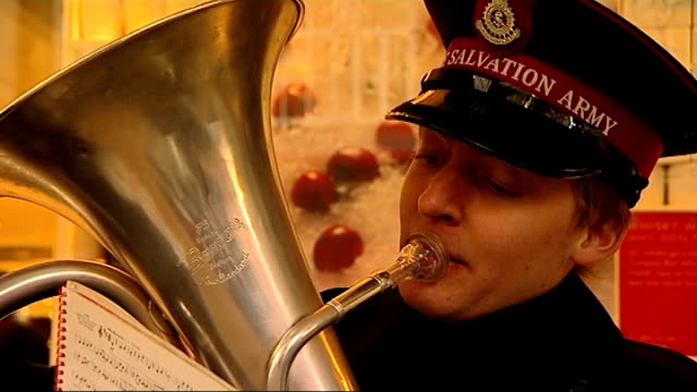 low consumer cofidence may hit christmas spending; salvation army band playing christmas songs - salvation army stock videos & royalty-free footage