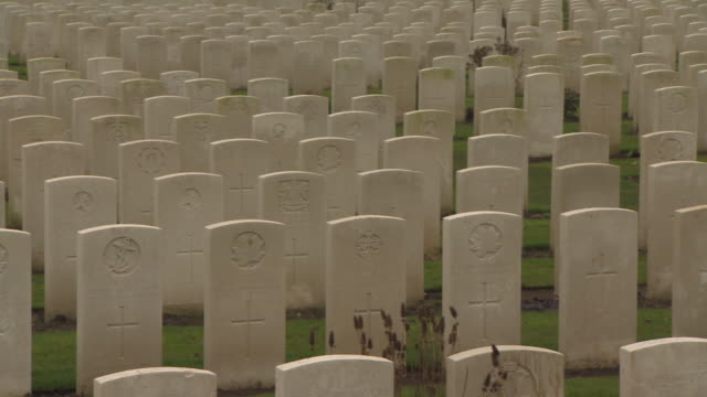 low crane shot showing a fullframe view of rows of headstones forming part of tyne cot cemetery for commonwealth soldiers of the first world war... - crane shot stock videos and b-roll footage