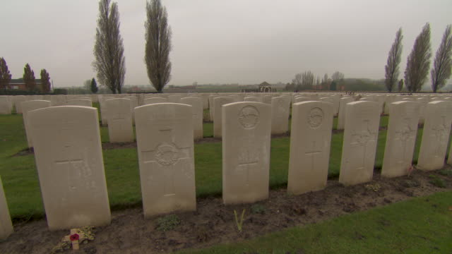low crane shot tracking past graves in tyne cot cemetery for commonwealth soldiers of the first world war belgium fkaz191x clip taken from programme... - cot stock videos & royalty-free footage